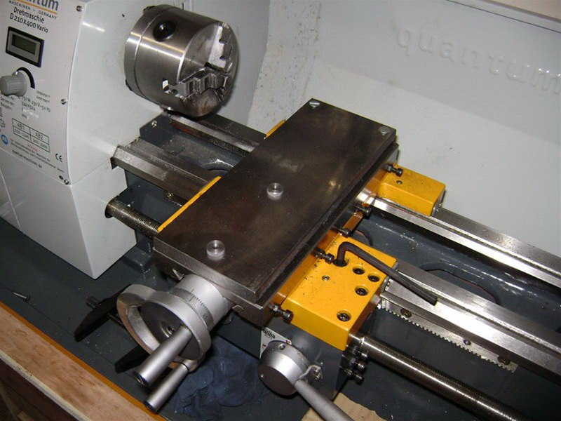 Quantum 210 x 400 lathe cross feed table with supplemental steel plate